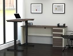 Sit Or Stand Desk by Stand Desk Affordable Sit To Stand Desk For Urban Professionals