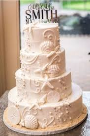 beachy wedding cakes themed white butter wedding cake with shells