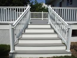 gray deck with white railings railing posts and white lattice