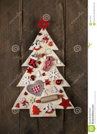 wooden handmade christmas tree with white and red decoration