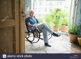 Old Man In Rocking Chair Mature Man Sitting In Rocking Chair Stock Photo Royalty Free