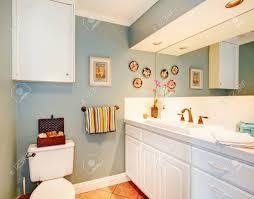 light blue bathroom cozy light blue bathroom with tile floor and white wood storage