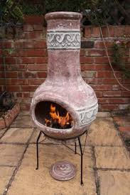 Ceramic Fire Pit Chimney - clay chimenea with mexico and chilli logo on the front this