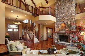 stack stone fireplace living room traditional with armchairs beige
