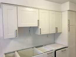 how to install cabinets with uneven ceiling bad kitchen cabinet install in condo need help improving