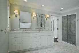 shower with gray subway tiles with marble basketweave shower floor