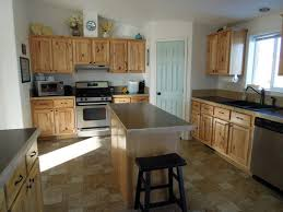what paint color goes best with hickory cabinets need flooring ideas to go with hickory cabinets