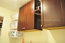 the laundry room makeover in progress utilizing a small space