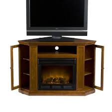 light brown wooden fireplace with black frame between shelves with