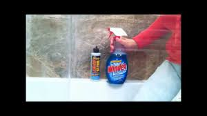 how to remove hard water spots from shower doors glass by using