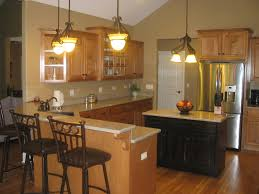 Kitchen Peninsula Design by Oak Cabinets Espresso Stained Island Cabinets Light Tan Counter
