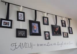 ideas for hanging family pictures including on walls without