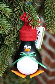 penguin tree ornament made from a recycled lightbulb