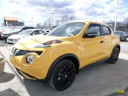 nissan yellow 2016 solar yellow nissan juke stinger edition awd 111661386 photo