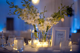 lighted centerpieces for wedding reception simple wedding reception centerpieces ivory flowers blue lighting