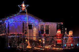 santa light display offers greetings on