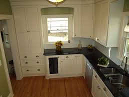 black walls white kitchen cabinets white cabinets black countertops with green walls ohana