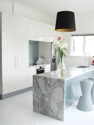 marble island kitchen dramatic marble slab with a waterfall edge for this custom kitchen