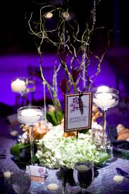 wedding centerpiece with white candle and flower arrangement also
