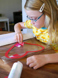 heart shaped writing paper little hiccups valentine heart sun catchers contact paper within the heart shape they can be as neat or as messy as they like overlapping the tissue paper and going over the edges of the heart