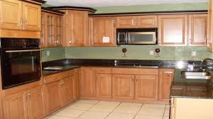 Kitchen Cabinet Door Replacement Brown Textured Wood Cabinet Combine Black Countertop Kitchen
