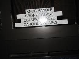 carolina arch fireplace bi fold bronze tinted glass door 37