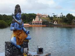 statue with statue with view of lake picture of ganga talao grand bassin