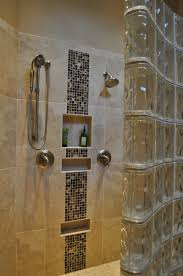 rustic bathroom with stacked stone tile and glass shower door also