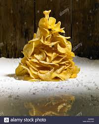 crisps piled up to create the shape of a christmas tree with icing