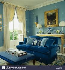 Living Room Blue Sofa by Upholstered Stool And Deep Blue Sofa With Toning Blue Cushions In