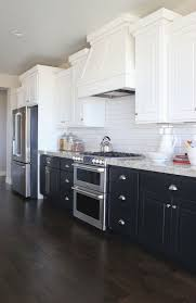 black bottom and white top kitchen cabinets the white up top to brighten and the bottom