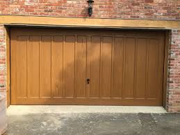 garage doors with door converting two single garage doors to a double south east garage