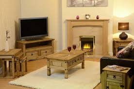beige fireplace and rectangle brown wooden table on white fur rug