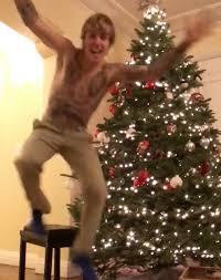 justin bieber decorates his tree shirtless