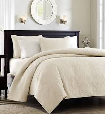 beige and white bedding products for creating warm and elegant