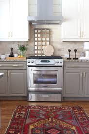 best 25 painted gray cabinets ideas on pinterest grey cabinets design indulgence before and after love this backsplash and paint color of the lower cabinets grey painted kitchen