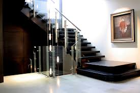 hand crafted open rise white oak stair with glass and stainless