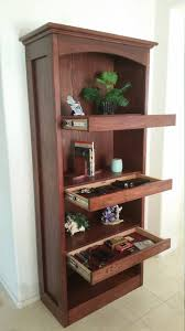 A Bookcase Excellent Idea For Usage Of Wasted Space Among Bookshelves In A
