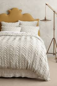 shop the textured chevron duvet and more anthropologie at