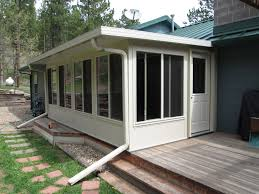 Adding Sunroom Enchanting Sunroom Patio Porch Deck Enclosures Property Fireplace