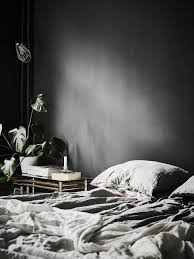 interiors to inspire black walls in the bedroom ambinteriors i love how the linen sheets are in a soft muted neutral colour to create a stunning contrast against the dark walls another favourite of mine is the gold