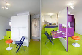 Hidden Kitchen Wall Transforms Into A Dining Room Table - Dining room table with hidden chairs