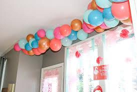 balloon garland diy balloon garland tutorial oh so lovely