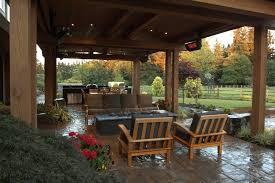 gorgeous covered stone patio with heaters gas fire pit and an