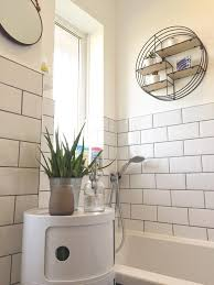 white bathroom with white metro tiles and grey grout and circular