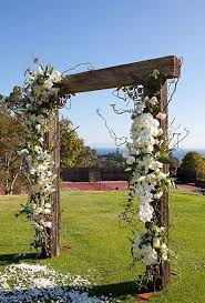 wedding arches to buy asymmetrical gorgeousness wooden arbor kiwi vine roses lilies