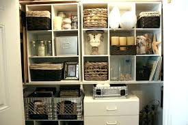 broom storage cabinet utility room or small laundry room closet