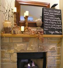 stacked brown stone fireplace with brown wooden mantel and brown