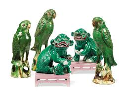 green foo dogs a pair of foo dogs and three green glazed models of hawks