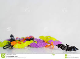 green and purple halloween background halloween bat ring party favors stock photo image 38389340